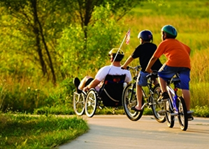 Family fun cycling in a park in Lawrence Kansas
